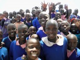 A crowd of Kenyan children smile and laugh as they stare into the car window at Anamosa veterinarian Brian Darrow in January, 2012. Darrow traveled to Kenya as part of Sharon's Project, which vaccinated thousands of animals during their trip. (Contributed by Brian Darrow)
